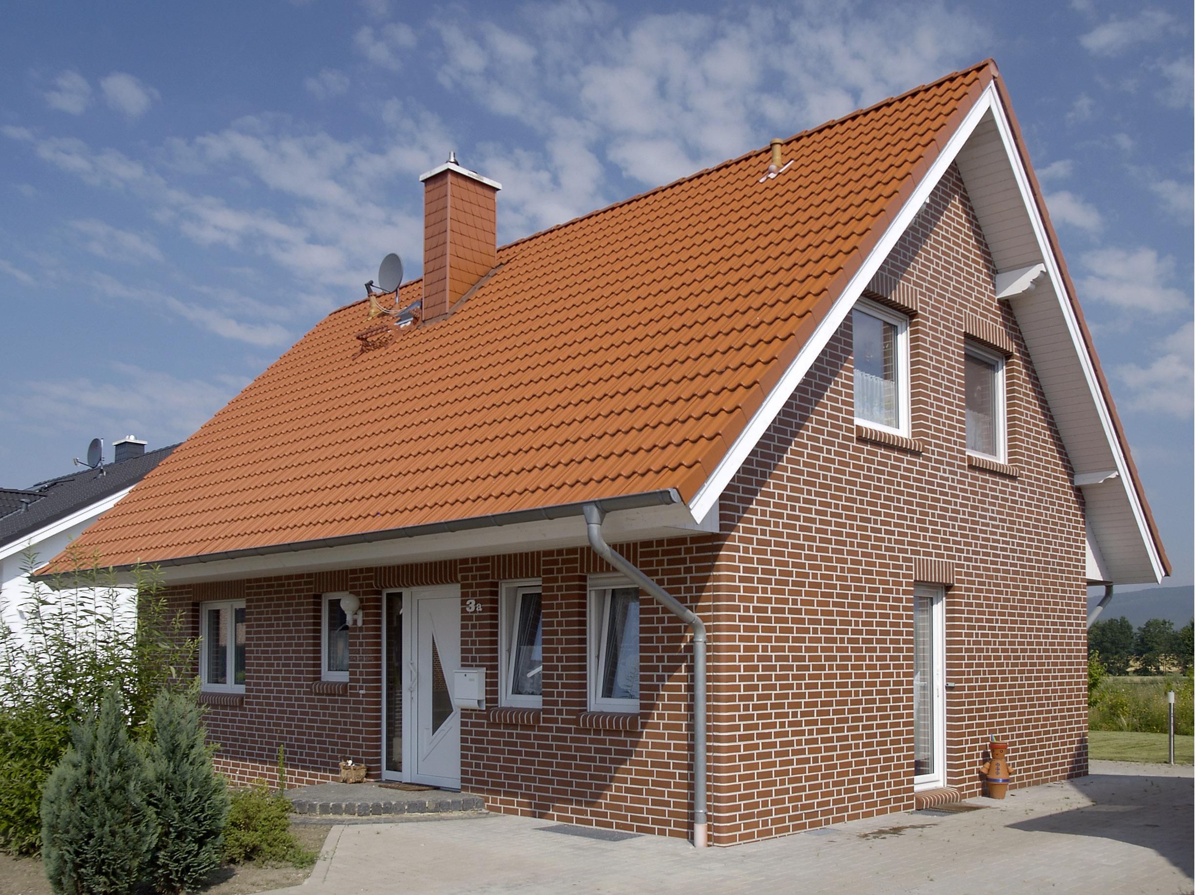 Фото домов с красными крышами